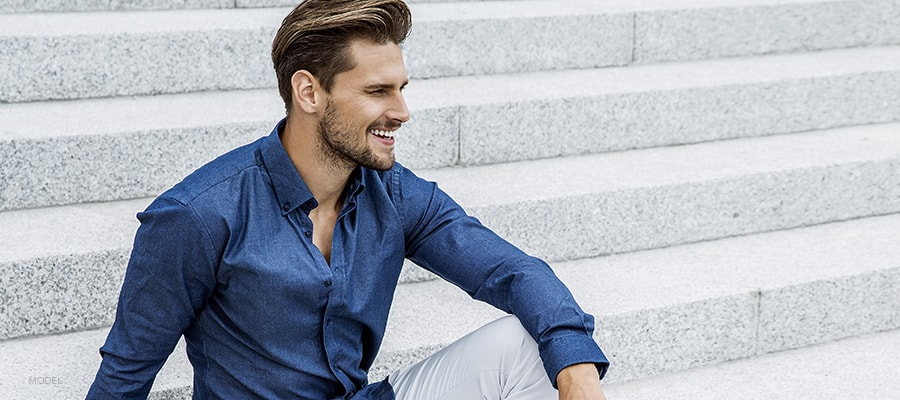 Handsome Male Model Smiling Away From Camera Full Size