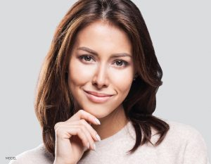 Brunette Female With Beige Nails and Sweater