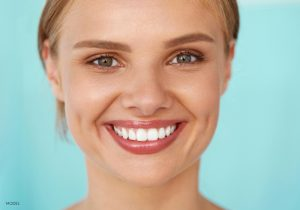 Blond Model With Large White Teeth
